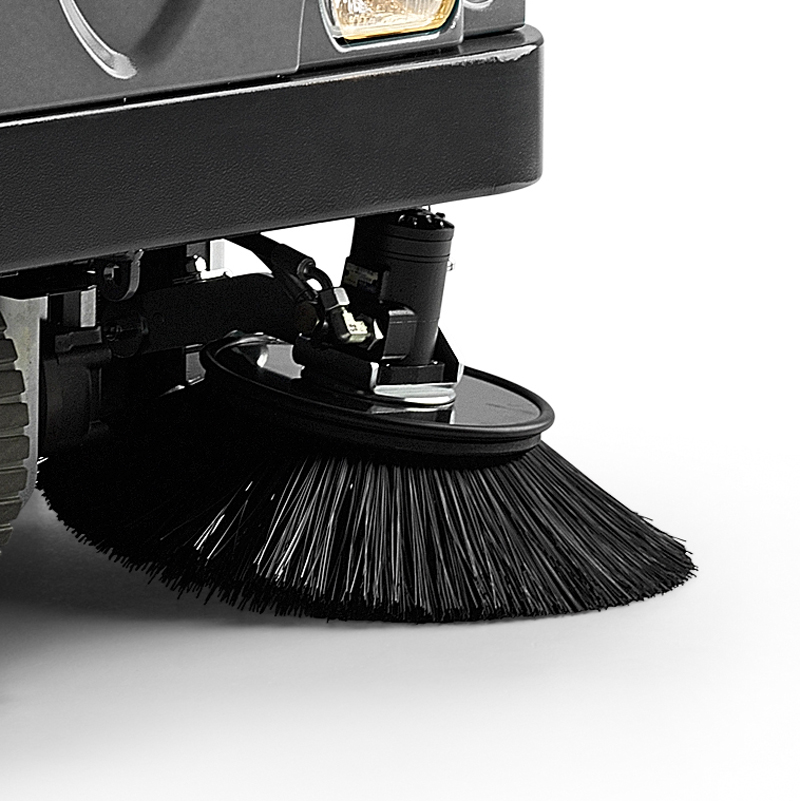 MACH 5 RIDE-ON SWEEPER HAS IMPACT RESISTANT SIDE-BRUSHES